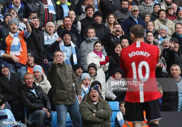 Wayne Rooney of Manchester United is mocked by home fans during the Barclays Premier League match between Manchester City and Manchester United at...