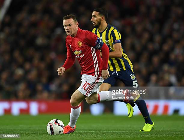 Wayne Rooney of Manchester United is pursued by Mehmet Topal of Fenerbahce during the UEFA Europa League Group A match between Manchester United FC...