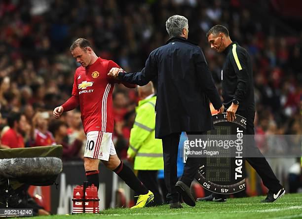 Wayne Rooney of Manchester United is substituted by Jose Mourinho Manager of Manchester United during the Premier League match between Manchester...