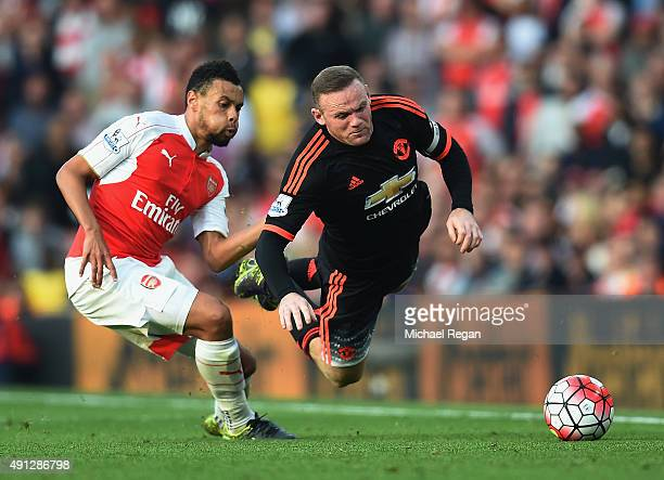 Wayne Rooney of Manchester United is tackled by Francis Coquelin of Arsenal during the Barclays Premier League match between Arsenal and Manchester...