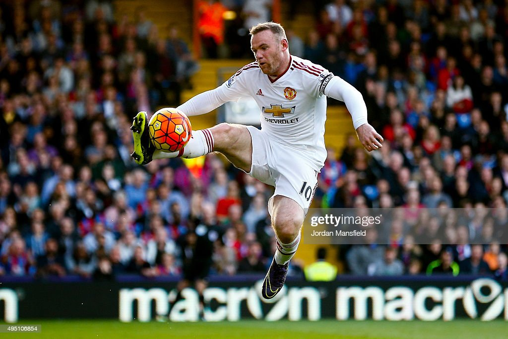 Wayne Rooney of Manchester United jumps for a ball during the Barclays Premier League match between Crystal Palace and Manchester United at Selhurst Park on October 31, 2015 in London, England.
