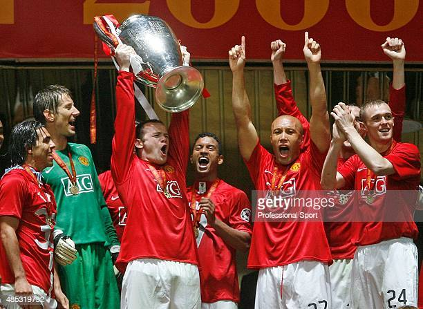Wayne Rooney of Manchester United lift the trophy following their team's 65 victory in the penalty shootout during the UEFA Champions League Final...