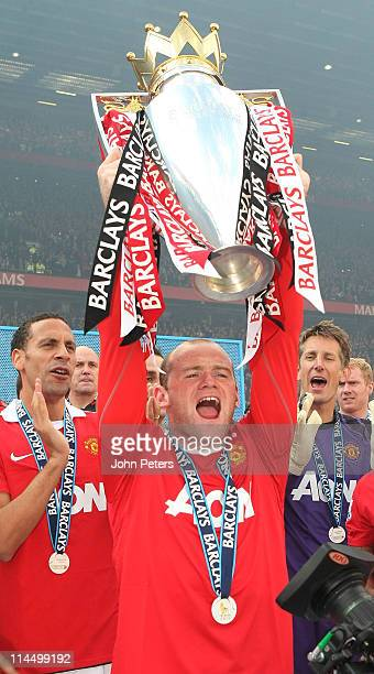Wayne Rooney of Manchester United lifts the Barclays Premier League trophy after the Barclays Premier League match between Manchester United and...