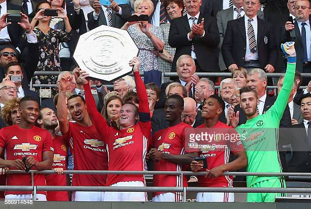 Wayne Rooney of Manchester United lifts the Community Shield trophy after the FA Community Shield match between Leicester City and Manchester United...