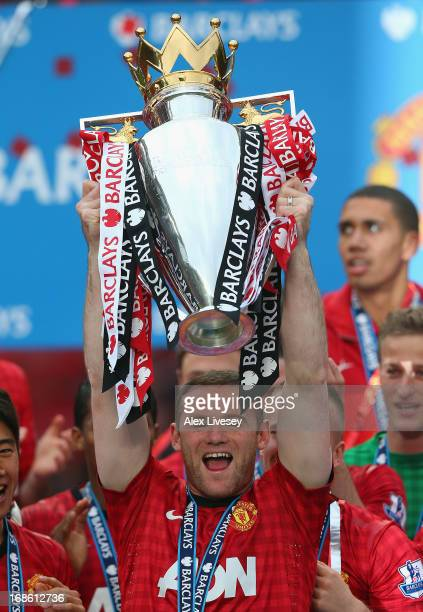 Wayne Rooney of Manchester United lifts the Premier League trophy following the Barclays Premier League match between Manchester United and Swansea...