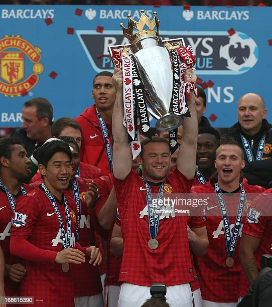 Wayne Rooney of Manchester United lifts the Premier League trophy after the Barclays Premier League match between Manchester United and Swansea City...