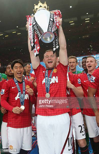 Wayne Rooney of Manchester United lifts the Premier League trophy after the Barclays Premier League match between Manchester United and Swansea at...
