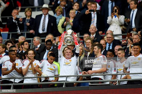 Wayne Rooney of Manchester United lifts the trophy after winning The Emirates FA Cup Final match between Manchester United and Crystal Palace at...