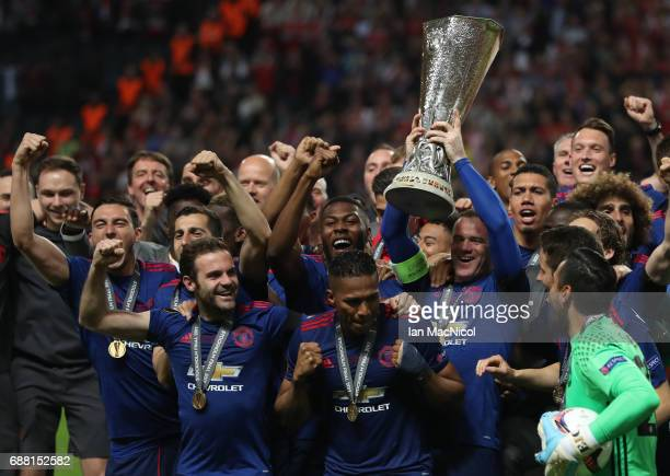Wayne Rooney of Manchester United lifts the trophy during the UEFA Europa League Final match between Ajax and Manchester United at Friends Arena on...