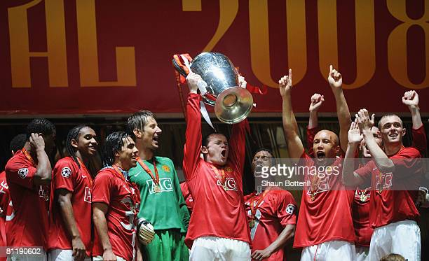 Wayne Rooney of Manchester United lifts the trophy following his team's 65 victory in the penalty shootout during the UEFA Champions League Final...
