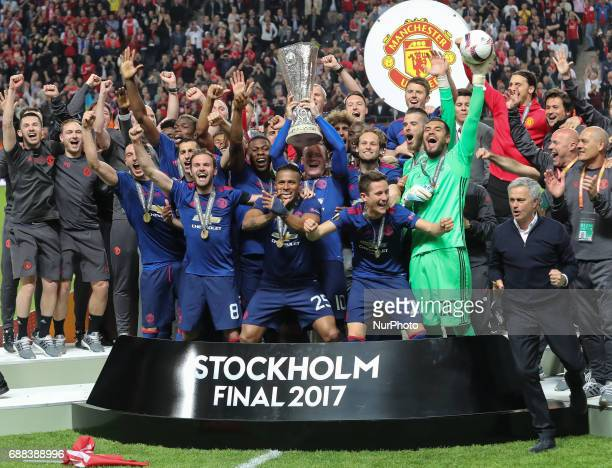 Wayne Rooney of Manchester United lifts the trophy following the UEFA Europa League Final match between Ajax and Manchester United at Friends Arena...