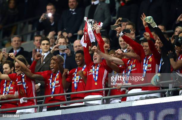 Wayne Rooney of Manchester United lifts the trophy in victory after during the EFL Cup Final between Manchester United and Southampton at Wembley...