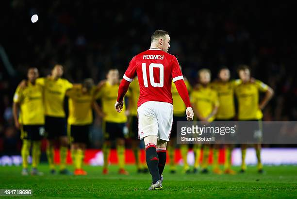 Wayne Rooney of Manchester United looks dejected after failing to score in the penalty shoot out during the Capital One Cup Fourth Round match...