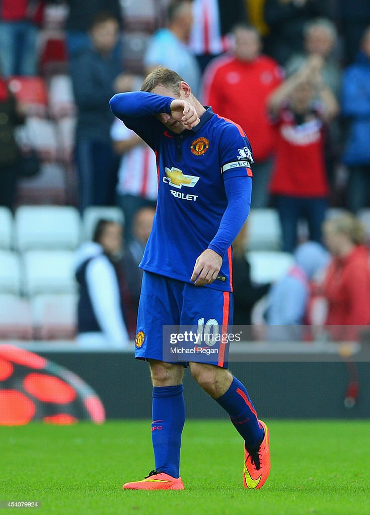 Wayne Rooney of Manchester United looks dejected after the Barclays Premier League match between Sunderland and Manchester United at Stadium of Light on August 24, 2014 in Sunderland, England.