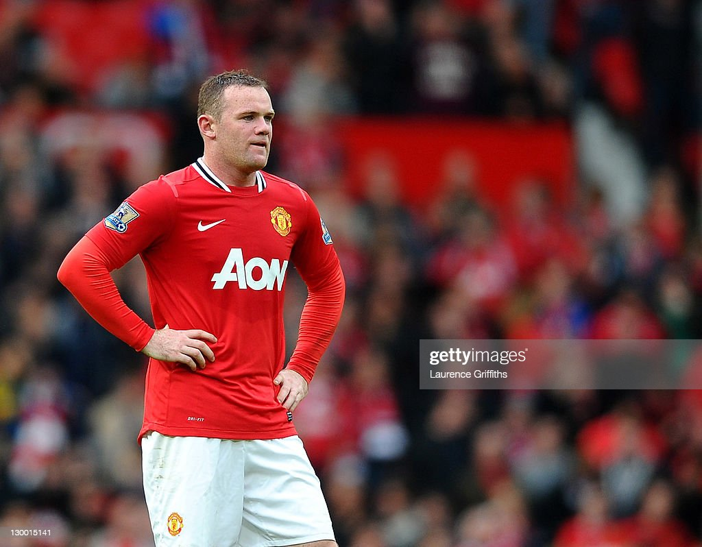 Wayne Rooney of Manchester United looks dejected during the Barclays Premier League match between Manchester United and Manchester City at Old Trafford on October 23, 2011 in Manchester, England.