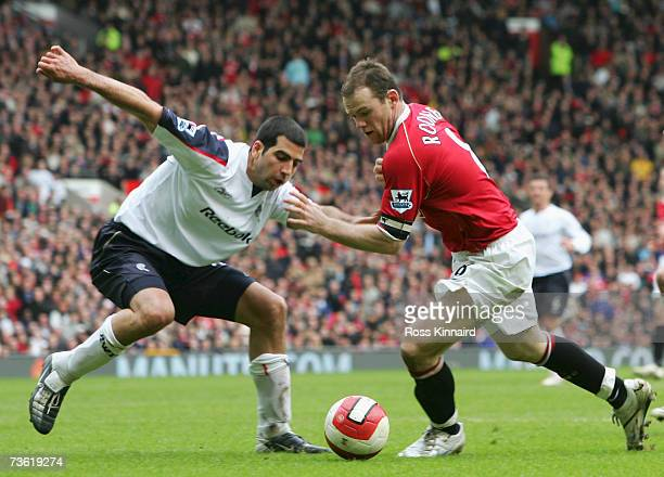 Wayne Rooney of Manchester United looks for a way past Tal Ben Haim of Bolton Wanderers during the Barclays Premiership match between Manchester...