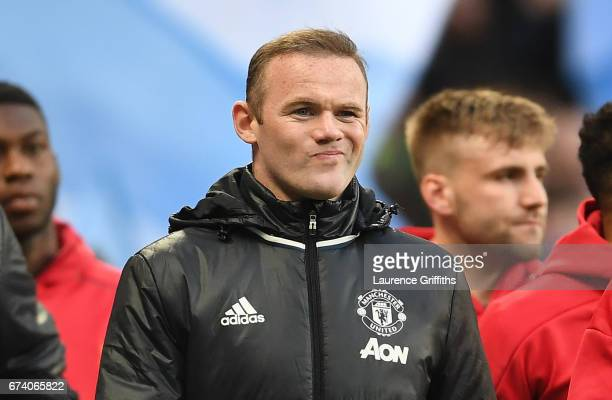Wayne Rooney of Manchester United looks on as he makes his way to the bench prior to the Premier League match between Manchester City and Manchester...