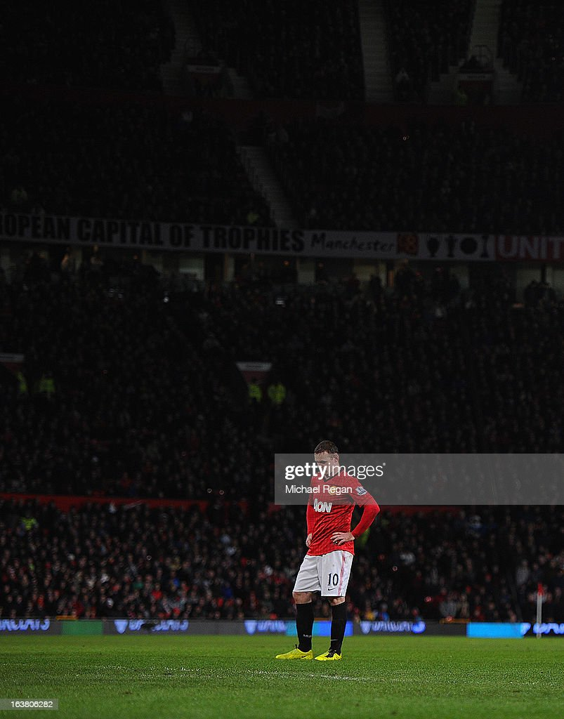 <a gi-track='captionPersonalityLinkClicked' href=/galleries/search?phrase=Wayne+Rooney&family=editorial&specificpeople=157598 ng-click='$event.stopPropagation()'>Wayne Rooney</a> of Manchester United looks on during the Barclays Premier League match between Manchester United and Reading at Old Trafford on March 16, 2013 in Manchester, England.