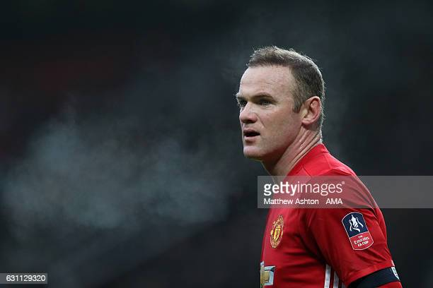 Wayne Rooney of Manchester United looks on during the Emirates FA Cup third round match between Manchester United and Reading at Old Trafford on...