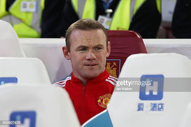 Wayne Rooney of Manchester United looks on from the subtitutes bench during The Emirates FA Cup sixth round replay between West Ham United and...