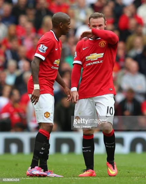 Wayne Rooney of Manchester United looks on with teammate Ashley Young during the Barclays Premier League match between Manchester United and Swansea...