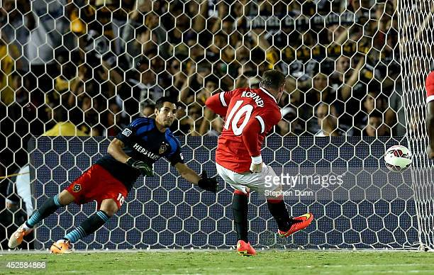 Wayne Rooney of Manchester United makes a penalty kick against goal keeper Jaime Penedo of the Los Angeles Galaxy in the first half at the Rose Bowl...