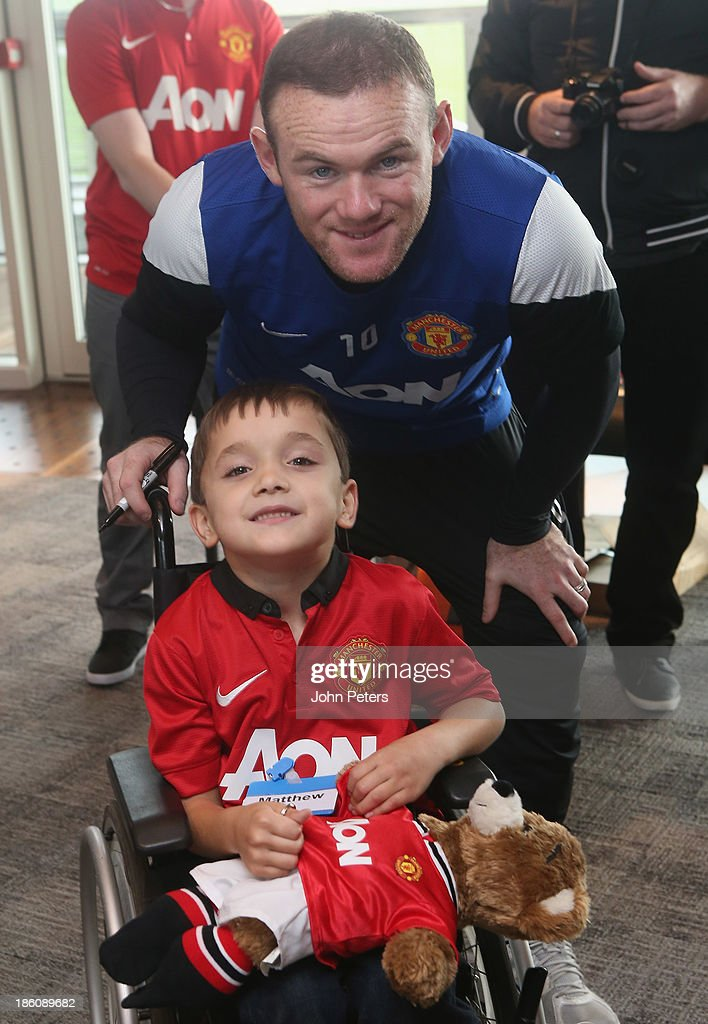 <a gi-track='captionPersonalityLinkClicked' href=/galleries/search?phrase=Wayne+Rooney&family=editorial&specificpeople=157598 ng-click='$event.stopPropagation()'>Wayne Rooney</a> of Manchester United meets Matthew Townrow during a Manchester United Foundation Dream Day, for fans with life-limiting illnesses, at Aon Training Complex on October 28, 2013 in Manchester, England.