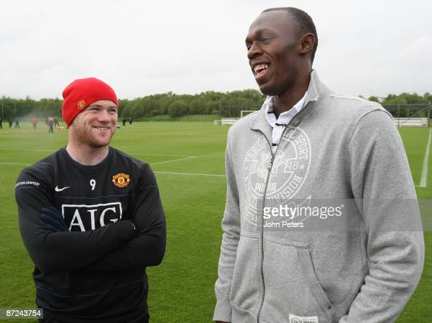 ACCESS *** Wayne Rooney of Manchester United meets Olympic Champion Usain Bolt ahead of a First Team Training Session at Carrington Training Ground...