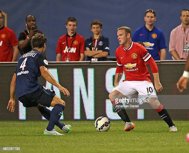 Wayne Rooney of Manchester United moves against Benjamin Stambouli of Paris SaintGermain during a match in the 2015 International Champions Cup at...