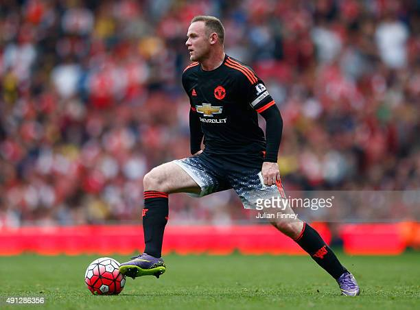Wayne Rooney of Manchester United on the ball during the Barclays Premier League match between Arsenal and Manchester United at Emirates Stadium on...
