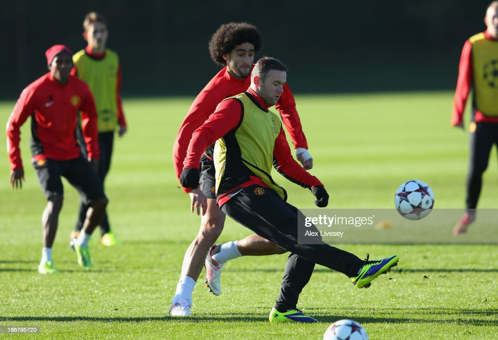 <a gi-track='captionPersonalityLinkClicked' href=/galleries/search?phrase=Wayne+Rooney&family=editorial&specificpeople=157598 ng-click='$event.stopPropagation()'>Wayne Rooney</a> of Manchester United passes the ball past <a gi-track='captionPersonalityLinkClicked' href=/galleries/search?phrase=Marouane+Fellaini&family=editorial&specificpeople=3936316 ng-click='$event.stopPropagation()'>Marouane Fellaini</a> during a training session at Aon Training Complex on November 4, 2013 in Manchester, England.