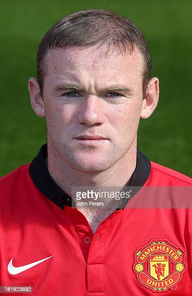 Wayne Rooney of Manchester United poses at the annual club photocall at Old Trafford on September 26 2013 in Manchester England
