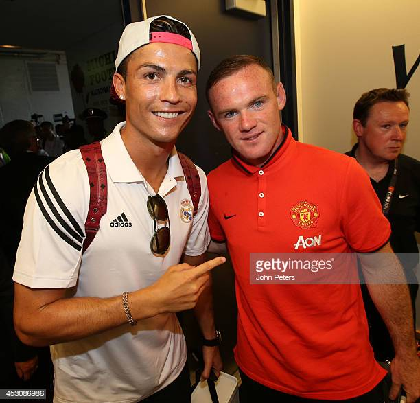 Wayne Rooney of Manchester United poses with Cristiano Ronaldo of Real Madrid after their preseason friendly match against Real Madrid at Michigan...