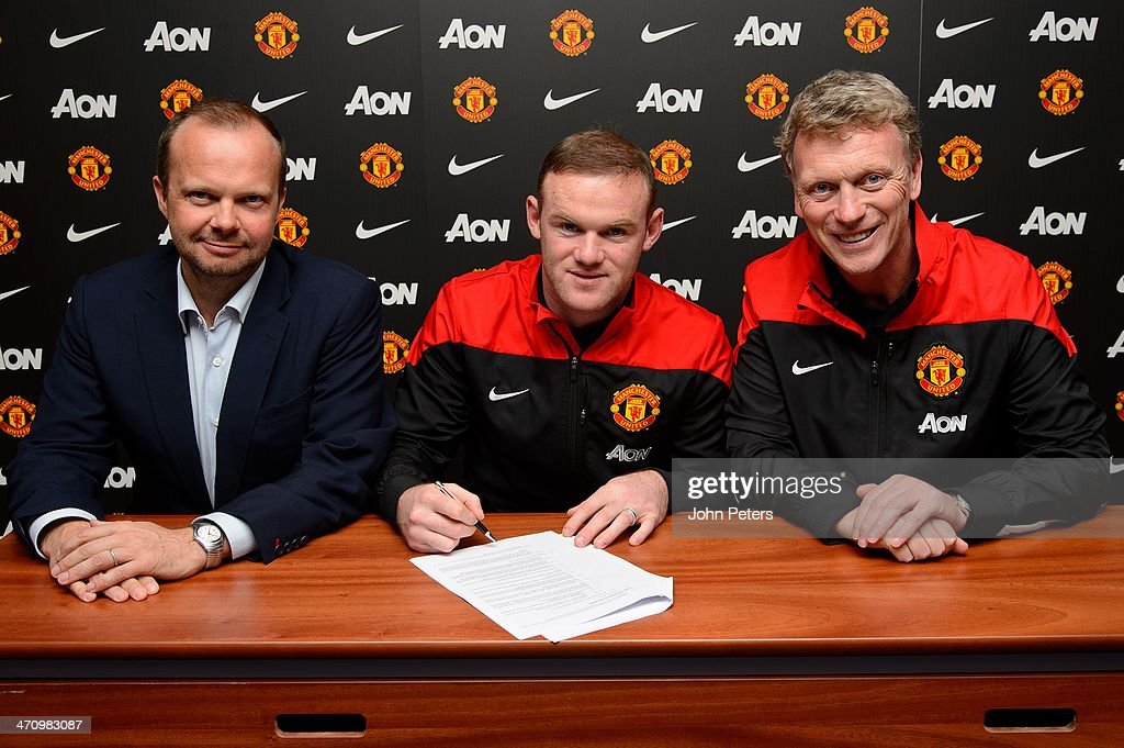 (MINIMUM PRINT/BROADCAST FEE OF GBP 150, ONLINE FEE OF GBP 75 PER IMAGE, OR LOCAL EQUIVALENT) Wayne Rooney (C) of Manchester United poses with Manager David Moyes (R) and Executive Vice Chairman Ed Woodward after signing a contract extension at Corinthia Hotel on February 21, 2014 in London, England.