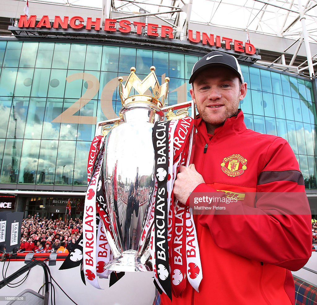 Wayne Rooney of Manchester United poses with the Premier League trophy at the start of the Premier League trophy winners parade on May 13, 2013 in Manchester, England.