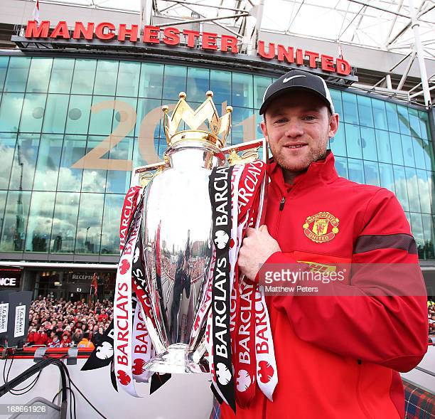 Wayne Rooney of Manchester United poses with the Premier League trophy at the start of the Premier League trophy winners parade on May 13 2013 in...