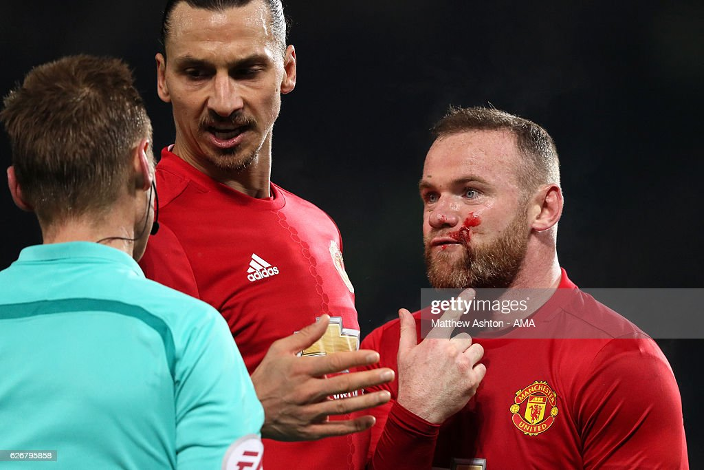 Wayne Rooney of Manchester United protests to Referee Mike Jones during the EFL Cup Quarter-Final match between Manchester United and West Ham United at Old Trafford on November 30, 2016 in Manchester, England.