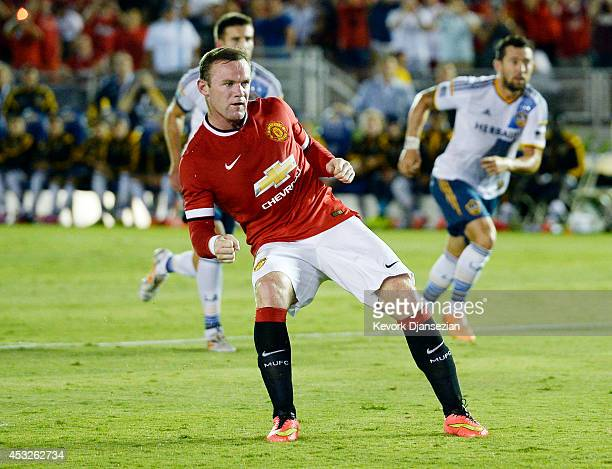 Wayne Rooney of Manchester United reacts after scoring on a penalty kick during the preseason friendly match between Los Angeles Galaxy and...