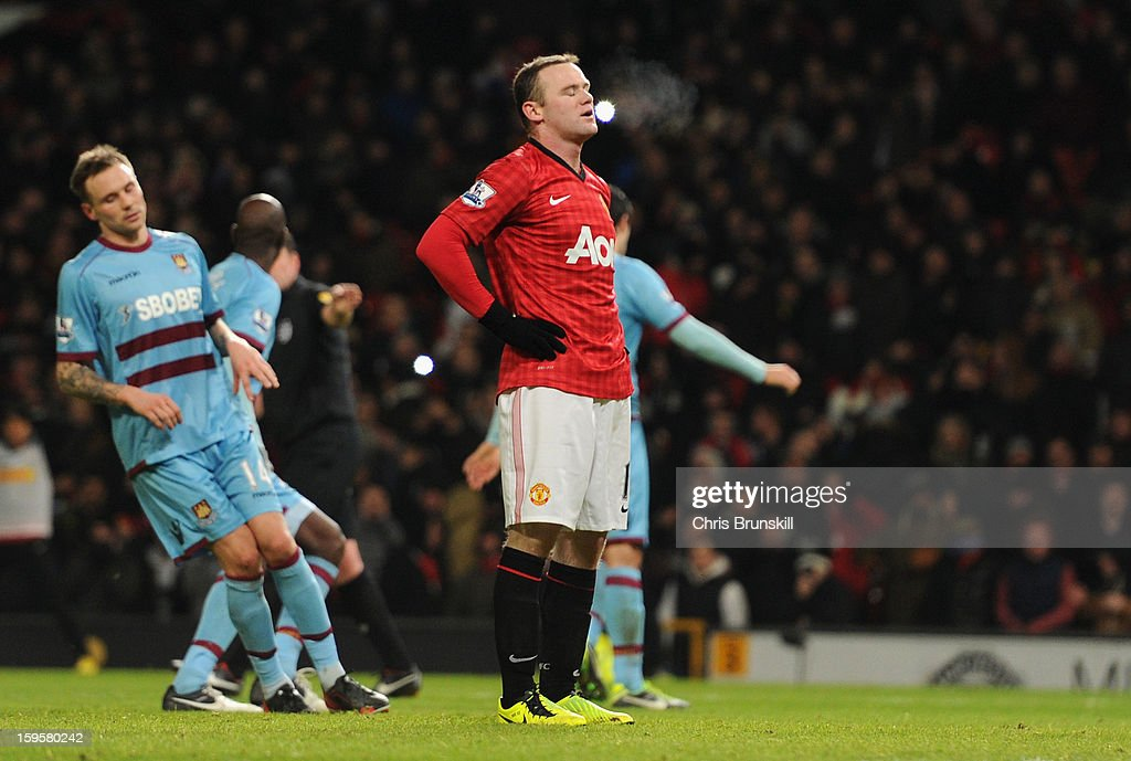 <a gi-track='captionPersonalityLinkClicked' href=/galleries/search?phrase=Wayne+Rooney&family=editorial&specificpeople=157598 ng-click='$event.stopPropagation()'>Wayne Rooney</a> of Manchester United reacts aftre missing a penalty kick during the FA Cup with Budweiser Third Round Replay match between Manchester United and West Ham United at Old Trafford on January 16, 2013 in Manchester, England.