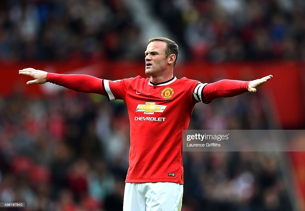 <a gi-track='captionPersonalityLinkClicked' href=/galleries/search?phrase=Wayne+Rooney&family=editorial&specificpeople=157598 ng-click='$event.stopPropagation()'>Wayne Rooney</a> of Manchester United reacts during the Barclays Premier League match between Manchester United and West Ham United at Old Trafford on September 27, 2014 in Manchester, England.