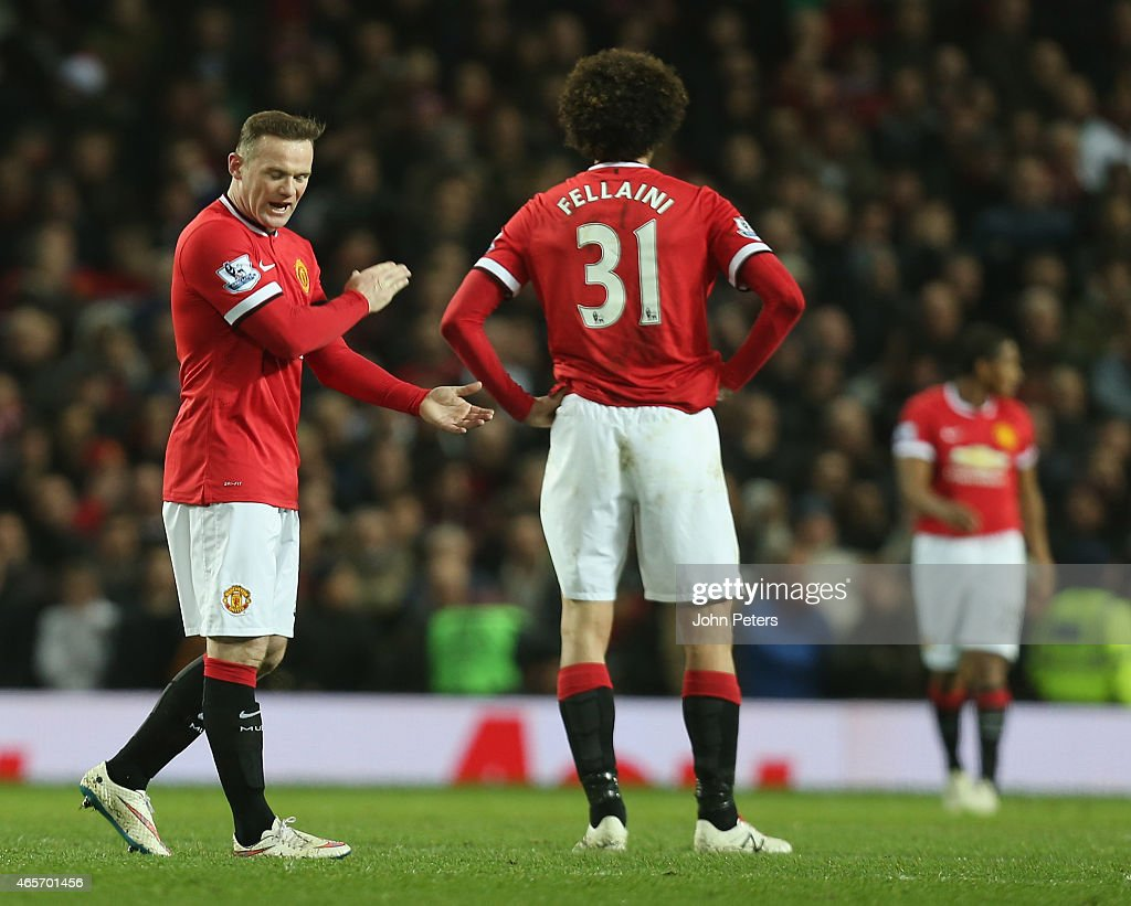 <a gi-track='captionPersonalityLinkClicked' href=/galleries/search?phrase=Wayne+Rooney&family=editorial&specificpeople=157598 ng-click='$event.stopPropagation()'>Wayne Rooney</a> of Manchester United reacts to <a gi-track='captionPersonalityLinkClicked' href=/galleries/search?phrase=Danny+Welbeck&family=editorial&specificpeople=4223930 ng-click='$event.stopPropagation()'>Danny Welbeck</a> of Arsenal scoring their second goal during the FA Cup Quarter Final match between Manchester United and Arsenal at Old Trafford on March 9, 2015 in Manchester, England.