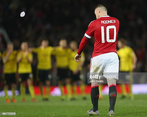 Wayne Rooney of Manchester United reacts to missing his penalty during the penalty shoot out during the Capital One Cup Fourth Round match between...