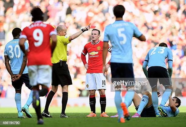 Wayne Rooney of Manchester United receives a straight red card by referee Lee Mason after a foul on Stewart Downing of West Ham during the Barclays...