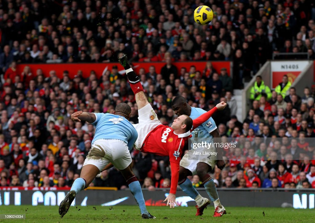 <a gi-track='captionPersonalityLinkClicked' href=/galleries/search?phrase=Wayne+Rooney&family=editorial&specificpeople=157598 ng-click='$event.stopPropagation()'>Wayne Rooney</a> of Manchester United scores a goal from an overhead kick during the Barclays Premier League match between Manchester United and Manchester City at Old Trafford on February 12, 2011 in Manchester, England.