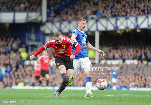 Wayne Rooney of Manchester United scores a goal to make it 03 during the Barclays Premier League match between Everton and Manchester United at...