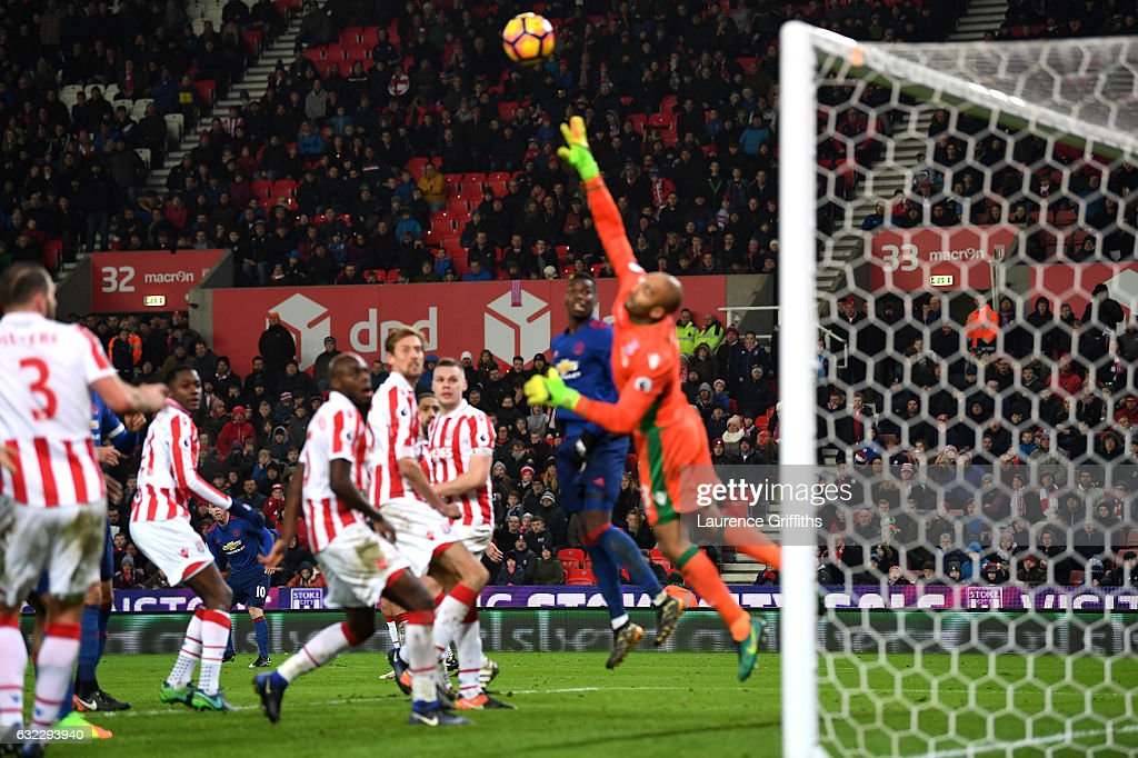 Wayne Rooney of Manchester United (obscure) scores his sides first goal during the Premier League match between Stoke City and Manchester United at Bet365 Stadium on January 21, 2017 in Stoke on Trent, England. Wayne Rooney scores his 250th goal for Manchester United in all competitions, which makes him the club's top goal scorer of all time. He surpasses the record previously held by Sir Bobby Charlton.
