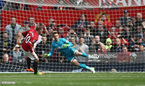 Wayne Rooney of Manchester United scores his sides first goal from the penalty spot during the Premier League match between Manchester United and...