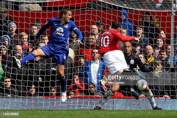 Wayne Rooney of Manchester United scores his team's first goal during the Barclays Premier League match between Manchester United and Everton at Old...