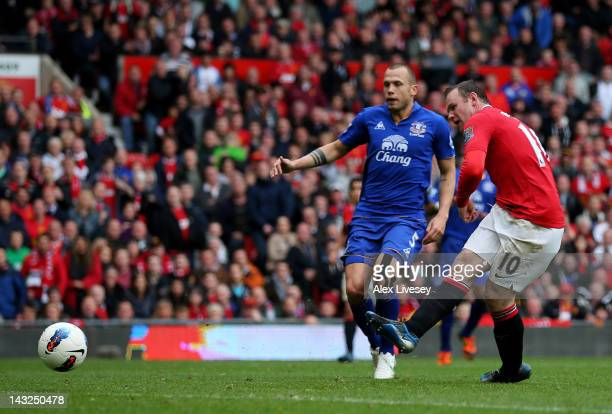 Wayne Rooney of Manchester United scores his team's fourth goal during the Barclays Premier League match between Manchester United and Everton at Old...