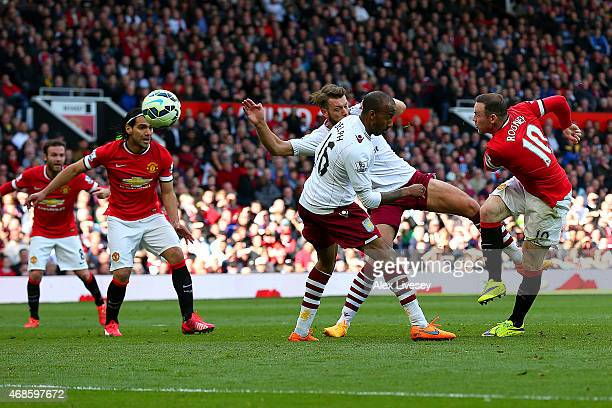 Wayne Rooney of Manchester United scores his team's second goal during the Barclays Premier League match between Manchester United and Aston Villa at...